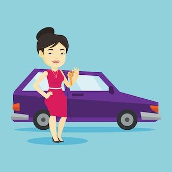 Kobieta trzyma klucze do swojego nowego samochodu.
