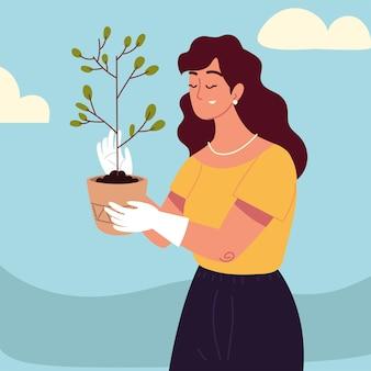 Kobieta trzyma roślinę