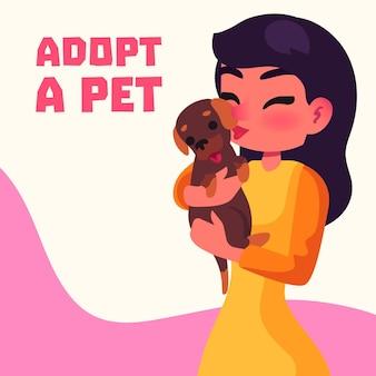 Kobieta trzyma ślicznego adoptowanego zwierzęcia domowego