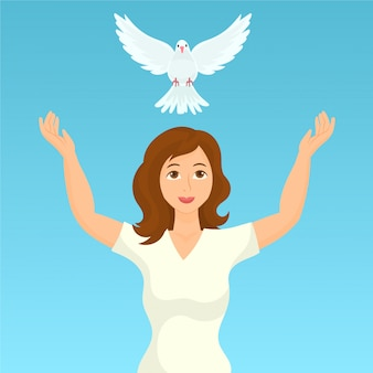 Kobieta uwalnia gołębicę pokoju