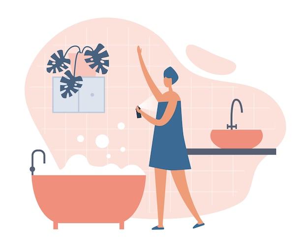 Kobieta używa dezodorant po brać skąpanie w domu