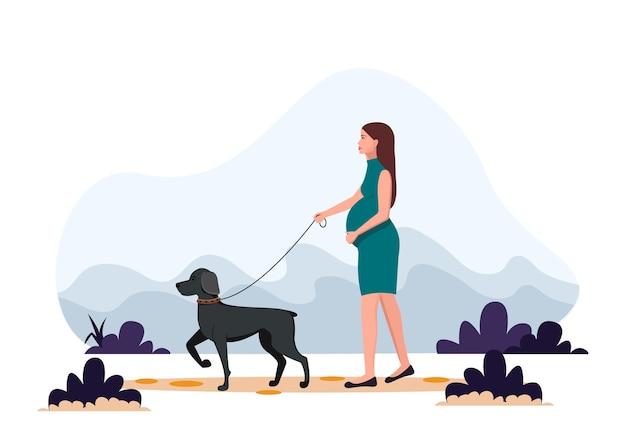 Kobieta w ciąży na spacerze z psem. zdrowy tryb życia, sport, ćwiczenia