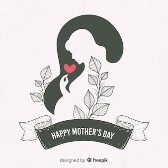 Kobieta w ciąży sylwetka matki dzień tło