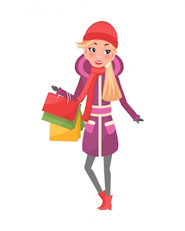 Kobieta w fioletowy płaszcz zimowy z pakietami w ręce
