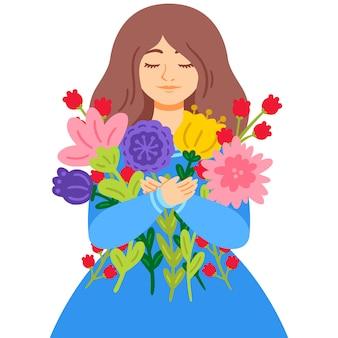 Kobieta w niebieskiej sukience z bukietem kwiatów. dzień matki. 8 marca międzynarodowy dzień kobiet z życzeniami.