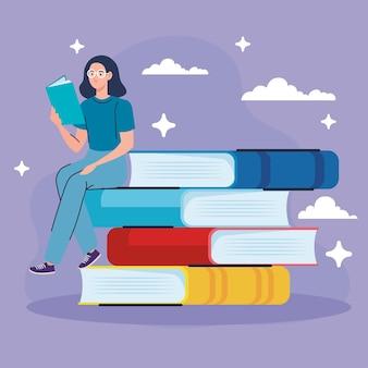 Kobieta w okularach czytania książki w pozycji siedzącej w książkach