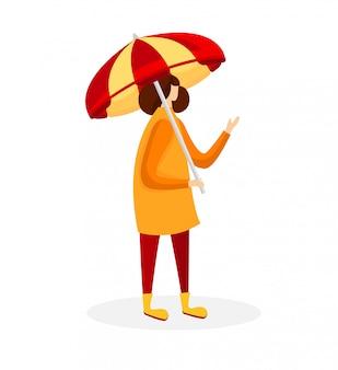 Kobieta w płaszcz i gumowe buty, trzymając parasol.