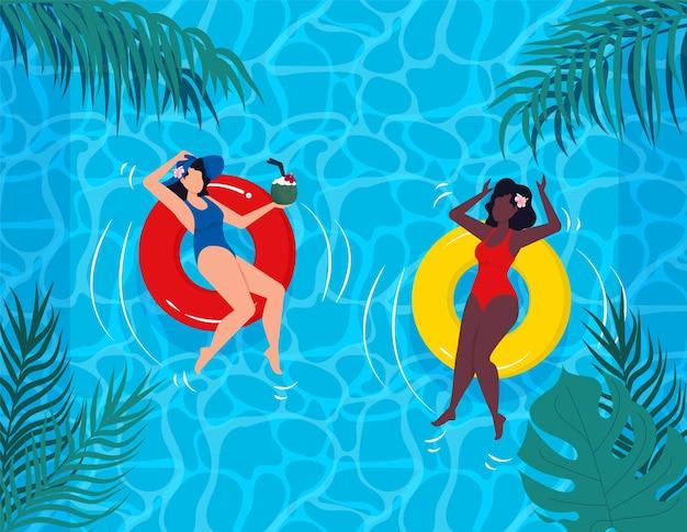 Kobieta w stroju kąpielowym letnie wakacje na gumowym pierścieniu basenu