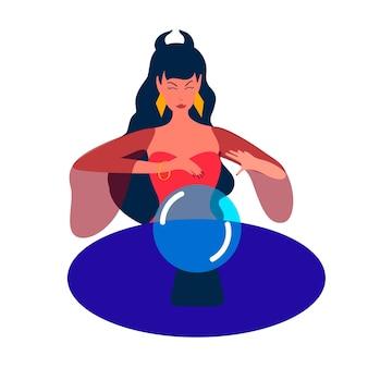 Kobieta wiedźma patrzy na wyrocznię z kryształowej kuli