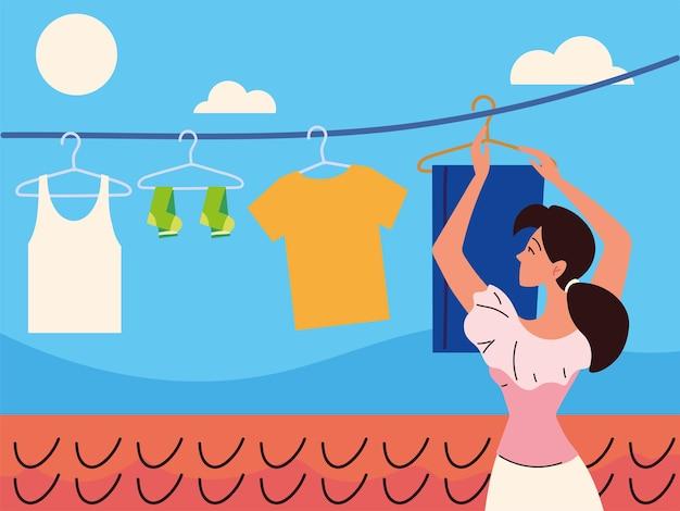 Kobieta wisząca ubrania