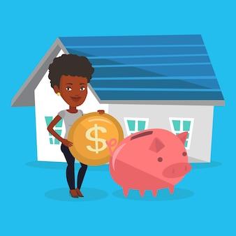 Kobieta wkłada pieniądze do skarbonki na zakup domu.