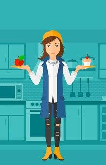 Kobieta z jabłkiem i ciastem.