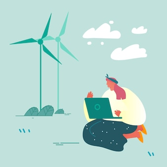 Kobieta z laptopa siedząc na ziemi