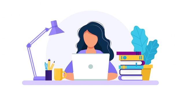 Kobieta z laptopem, studiowaniem lub pracującym pojęciem ,.