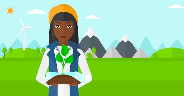 Kobieta z rośliny dorośnięciem w butelce