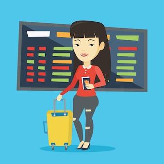 Kobieta z walizką i biletem na lotnisko.