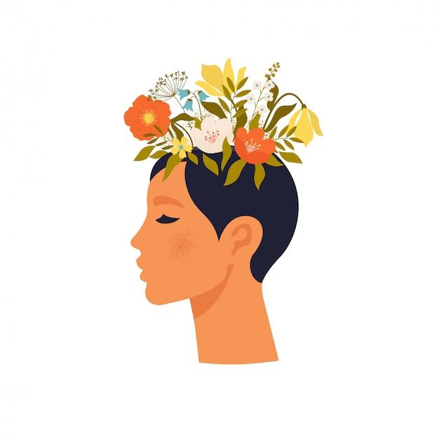 Kobieta z zamkniętymi oczami i kwiatami na głowie