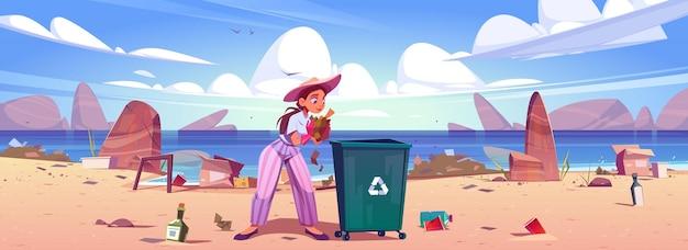 Kobieta zbiera śmieci do kosza na śmieci na plaży.