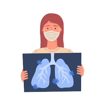 Kobieta zostaje zarażona koronawirusem. covid-19. kobieta trzyma prześwietlenie płuc.