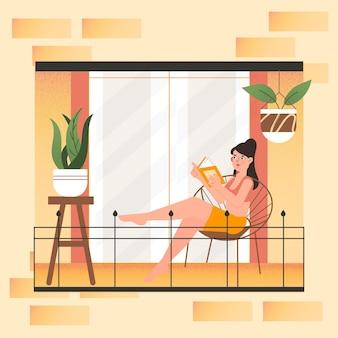 Kobiety czytanie na jej balkonowym staycation pojęciu