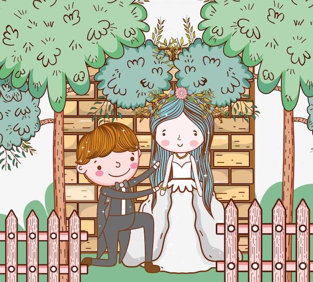 Kobiety i mężczyzna ślub z ogrodzeniem i drzewami