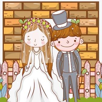 Kobiety i mężczyzna ślub z ogrodzeniem i ściana z cegieł