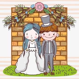 Kobiety i mężczyzna ślub z ściana z cegieł