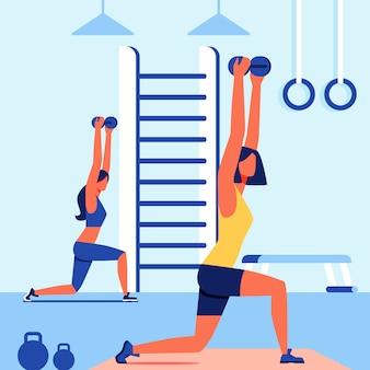Kobiety robią przysiady na siłowni. klasa fitness dla kobiety