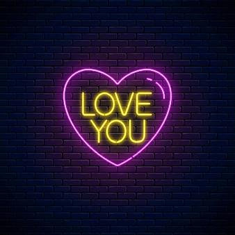 Kocham cię tekst w kształcie serca w stylu neonowym. happy valentines day neon świecące świąteczny znak na tle ciemnego ceglanego muru. kartkę z życzeniami świątecznymi z napisem. ilustracja wektorowa.