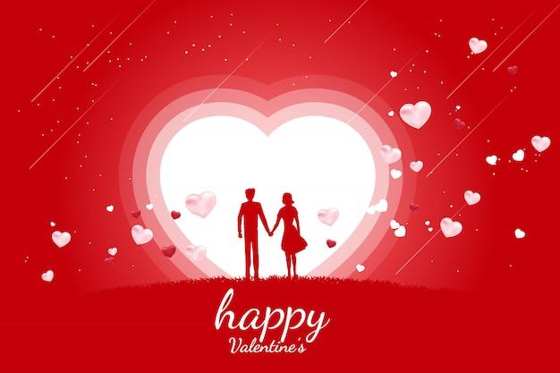 Kochanek para trzymając rękę z latania serce tło