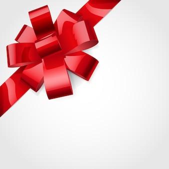 Kokarda wykonana z błyszczącej czerwonej wstążki. ozdoba na prezent.
