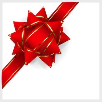 Kokarda wykonana z czerwonej wstążki w złote paski. ozdoba na prezent.