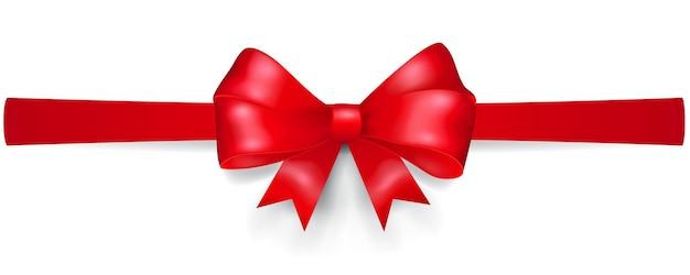 Kokarda z czerwonej wstążki, umieszczona poziomo, z cieniem