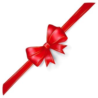 Kokarda z czerwonej wstążki ze złotymi paskami, ułożona ukośnie, z cieniem