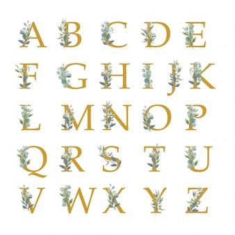 Kolekcja alfabetu z liśćmi w stylu przypominającym akwarele