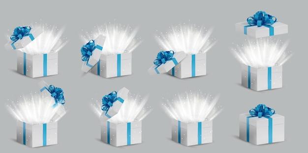 Kolekcja białe pudełko upominkowe z niebieską wstążką i kokardką na górze. otwierane i zamykane pudełko świąteczne z połyskującym wnętrzem i jasnymi promieniami światła. ilustracja.