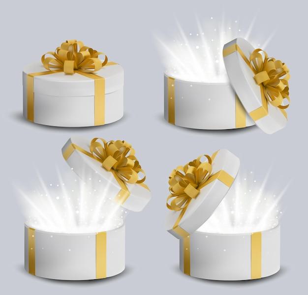 Kolekcja białe pudełko upominkowe ze złotą wstążką i kokardką na górze. świąteczne, okrągłe pudełko prezentowe z błyszczącymi elementami.