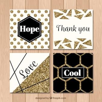 Kolekcja brokatowych kart o złotym kolorze