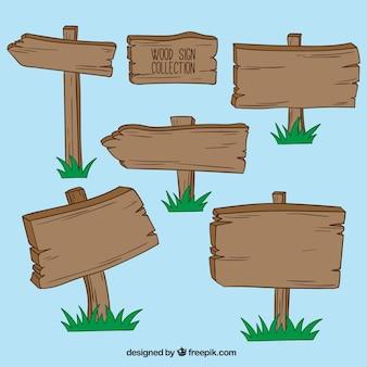Kolekcja drewnianych znaków z trawy