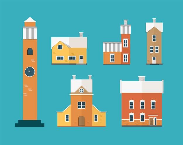 Kolekcja dwukondygnacyjnych budynków mieszkalnych i wieża zegarowa na białym tle na zielono