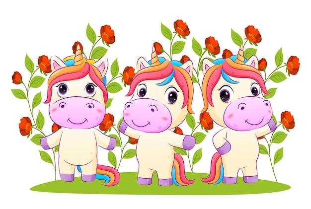 Kolekcja jednorożców pozuje w ogrodzie pełnym kwiatów z jasną kolorową ilustracją