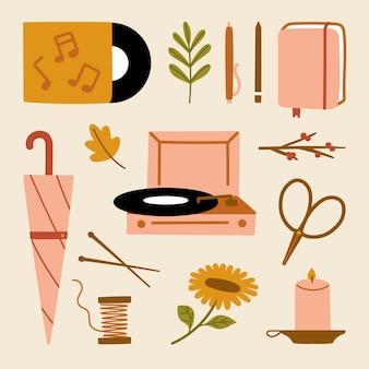 Kolekcja jesień domu przytulne elementy skandynawski styl hygge vintage płyta winylowa notatnik artykuły papiernicze parasol świeca narzędzia dziewiarskie słonecznik liście klonu ilustracja