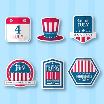 Kolekcja kapelusza, odznaki, etykiety lub naklejki wujka sam na niebieskim tle w paski.