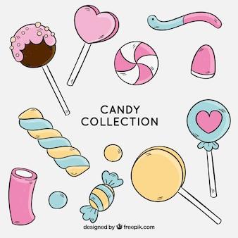 Kolekcja kolorowych cukierków w stylu wyciągnąć rękę