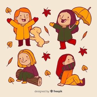 Kolekcja ludzi w parku jesienią