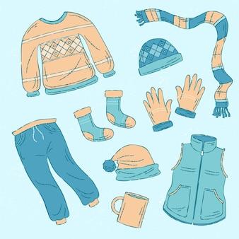 Kolekcja narysowanych przytulnych zimowych ubrań i niezbędnych rzeczy
