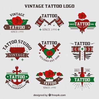 Kolekcja narysowanych ręcznie tatuaży logo