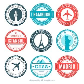 Kolekcja okrągłych znaczków z pomnikami