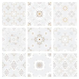 Kolekcja orientalnych szarych płytek mandali w tle