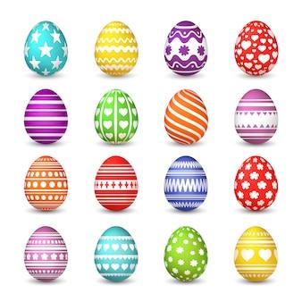 Kolekcja pisanek. chrześcijańskiego zmartwychwstania tradycji świętowania szczęśliwy easter jajko z kolorowym wzorem odizolowywającym